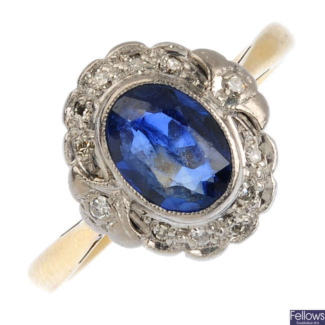 A mid 20th century 18ct gold and platinum, sapphire and diamond cluster ring.