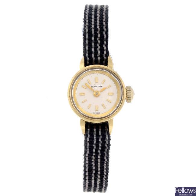 BLANCPAIN - a lady's yellow metal wrist watch.