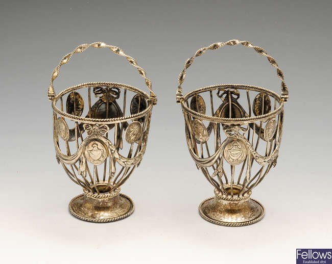 A pair of swing-handled baskets, probably George III.
