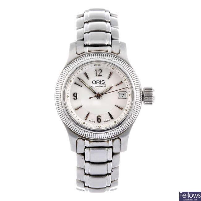 ORIS - a lady's stainless steel bracelet watch together with a lady's stainless steel Gucci 1800 L bracelet watch. .
