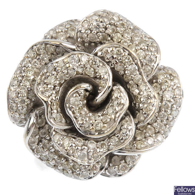An 18ct gold diamond floral dress ring.