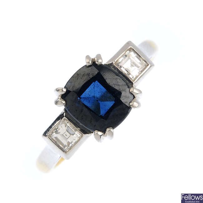 A sapphire and diamond three-stone ring.