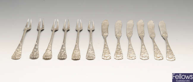 A set of Japanese silver pastry knives and forks.