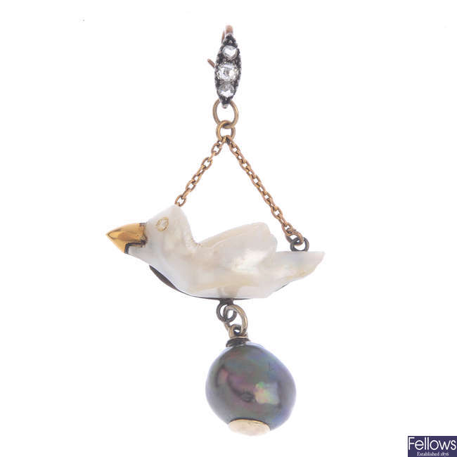 A pearl and diamond novelty pendant.