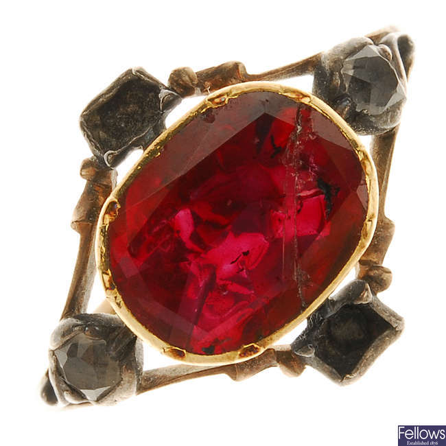 An early Georgian foil-back garnet and paste ring.