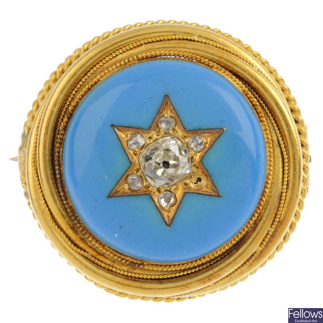An early 20th century gold diamond and enamel brooch.
