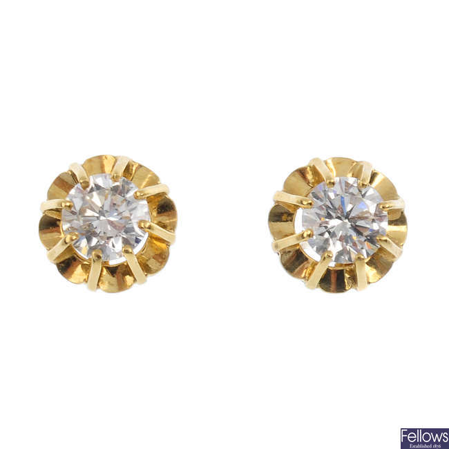 A pair of 18ct gold diamond ear studs.