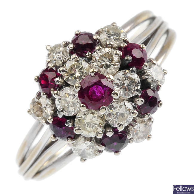 A 18ct gold diamond and ruby cluster ring.