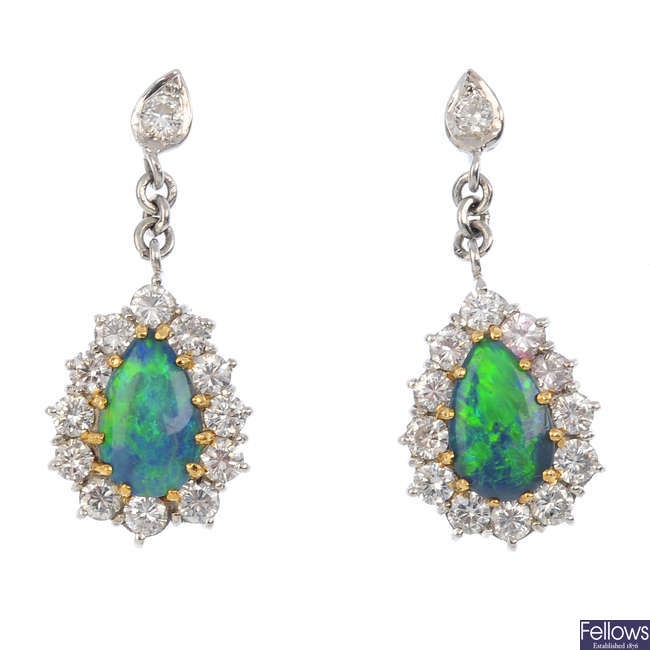 A pair of 18ct gold black opal and diamond earrings.