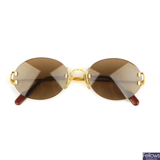 CARTIER - a pair of rimless sunglasses.