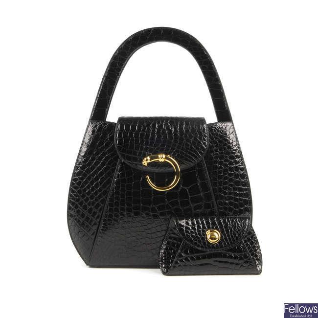 CARTIER - an early 90s alligator Pantere handbag with matching purse.
