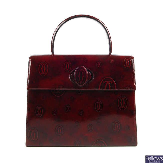 CARTIER - a vintage top handle Happy Birthday Bordeaux handbag.