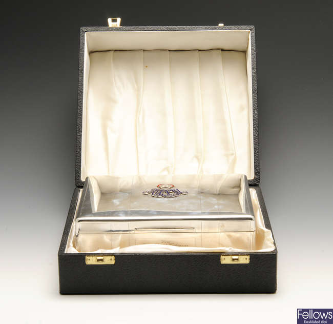 A George V silver mounted cigarette box presented by the Duke and Duchess of Connaught.