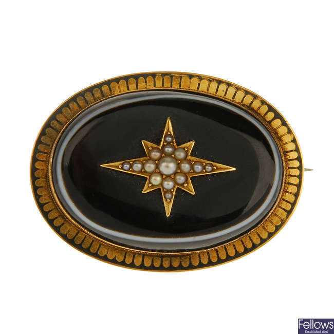A late Victorian banded agate and split pearl memorial brooch.