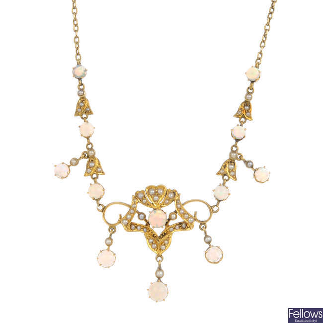 An early 20th century 15ct gold opal and split pearl necklace.