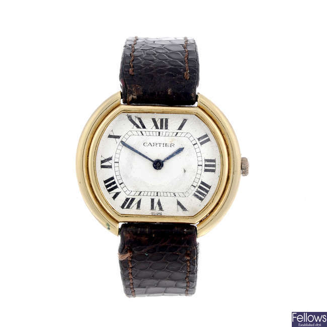 CARTIER - a yellow metal Ellipse wrist watch.