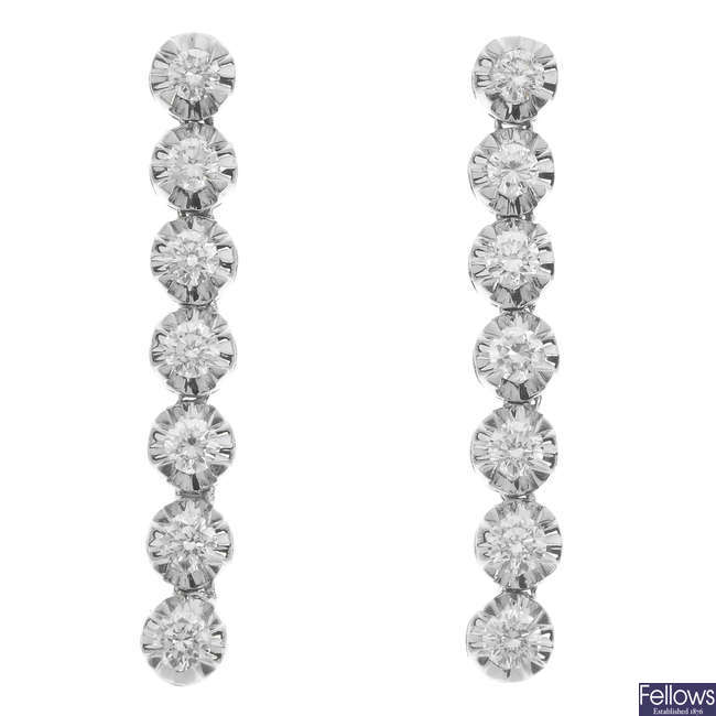 A pair of diamond earrings.