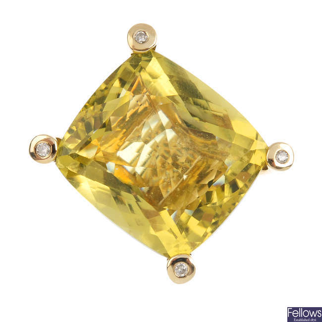 A 9ct gold yellow quartz and diamond dress ring.