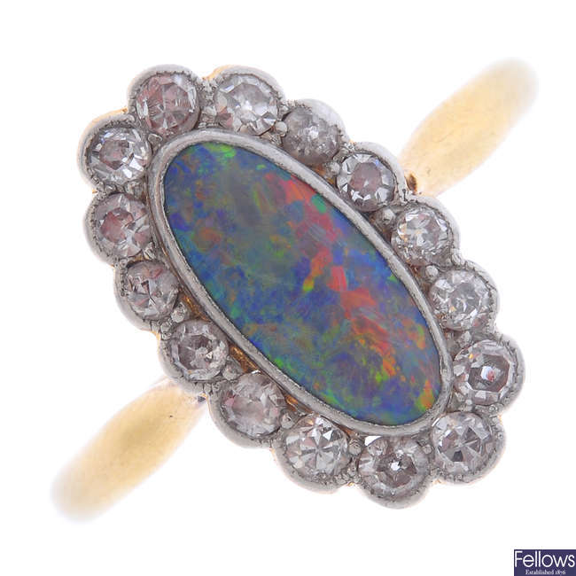 A black opal and diamond ring.