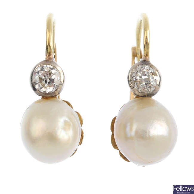A pair of natural pearl and diamond earrings.