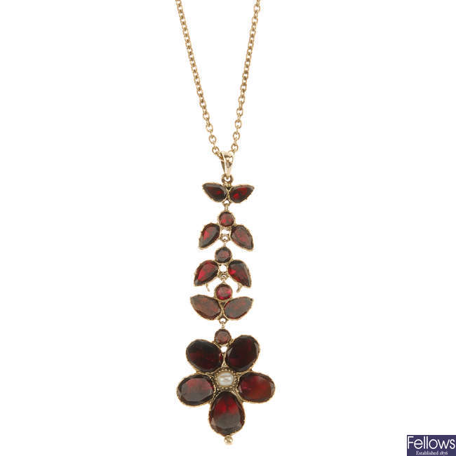 A late Georgian garnet and split pearl pendant with later added chain.