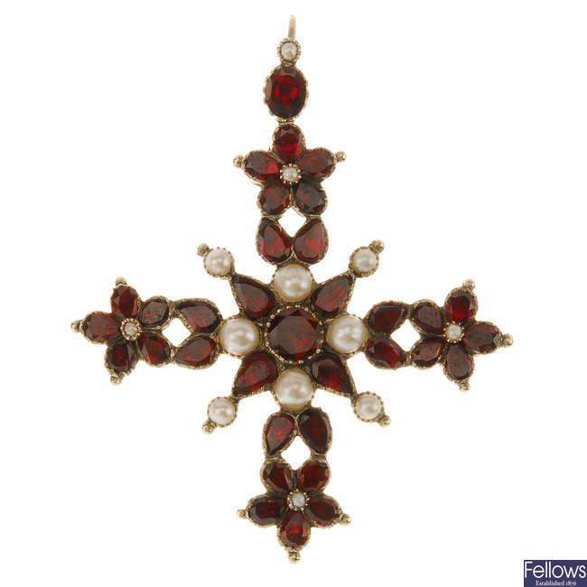 A garnet and split pearl cross pendant.