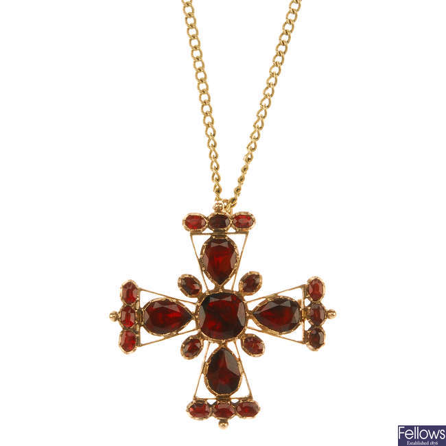 A late Georgian garnet cross pendant and a later added gold chain.