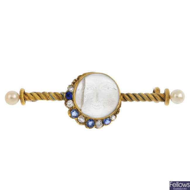 An early 20th century gold 'man in the moon' moonstone, diamond and gem-set brooch.