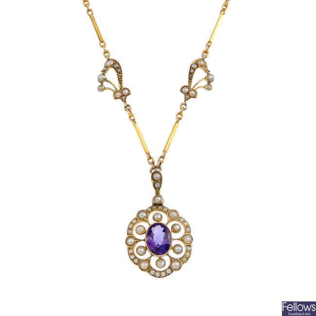 An early 20th century gold amethyst and split pearl necklace.
