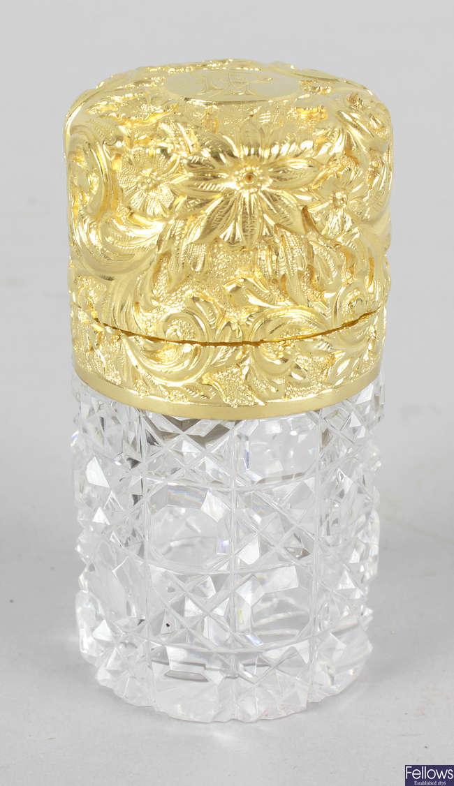 A silver gilt topped Sampson Mordan scent bottle.