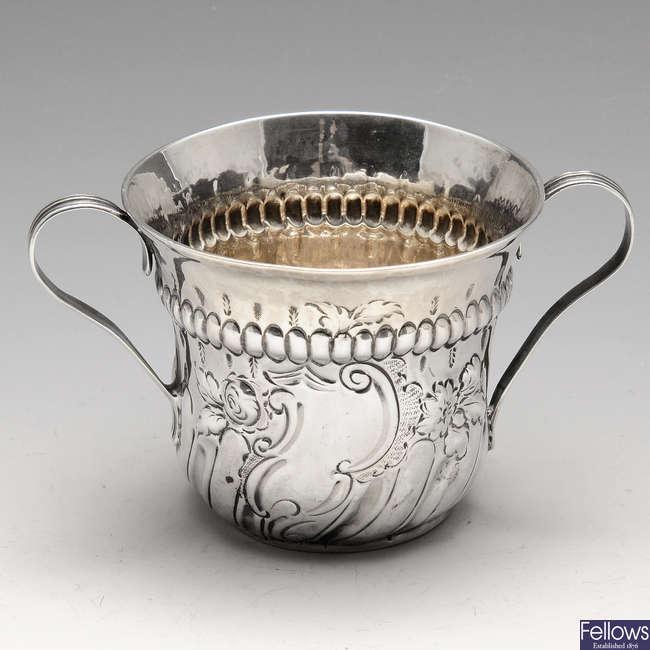 A George III silver porringer.
