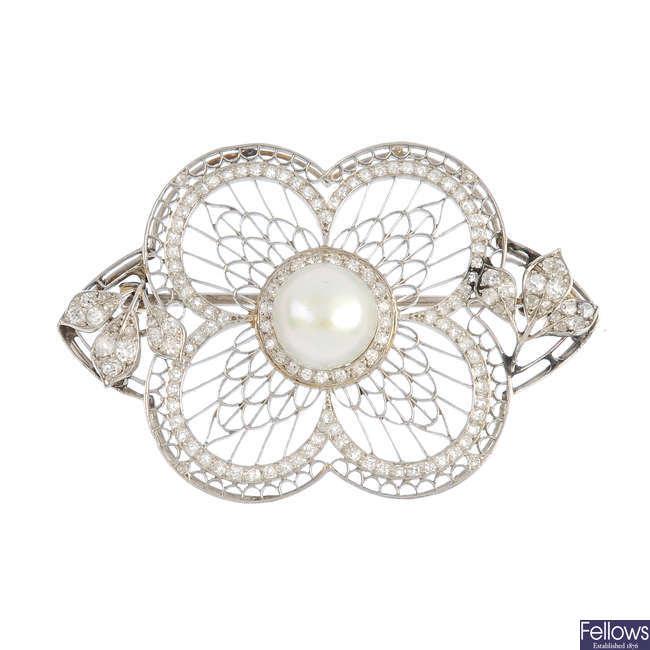 An Edwardian platinum, pearl and diamond brooch.