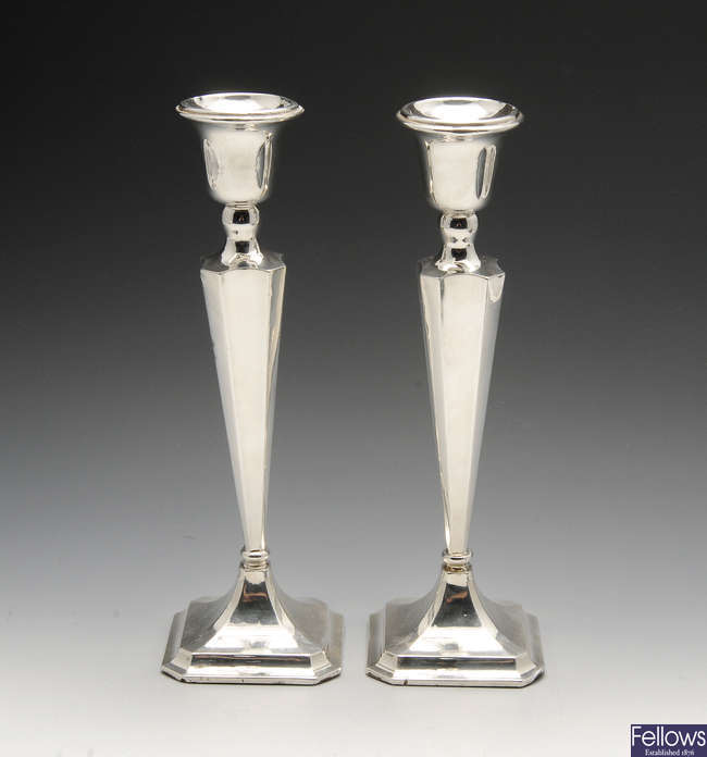 A pair of 1940's silver mounted candlesticks.