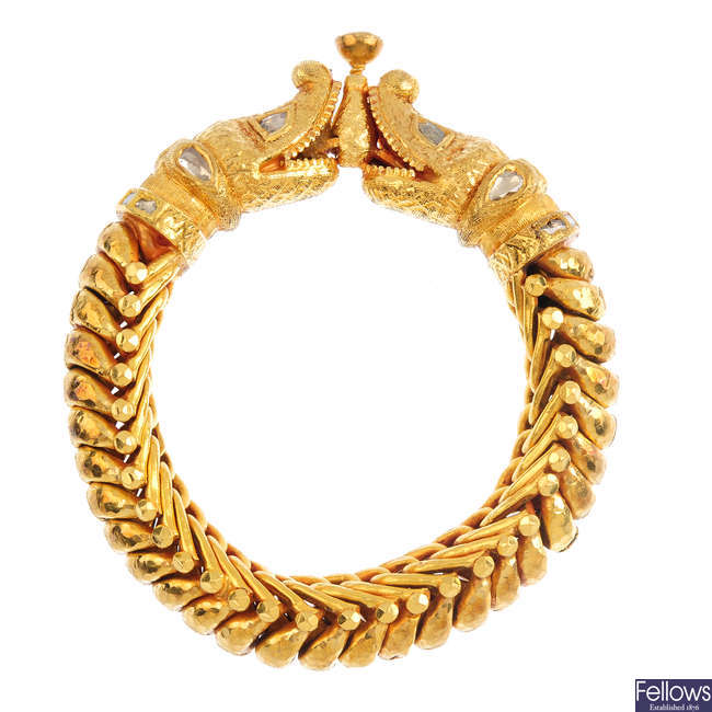 A diamond double-headed serpent bracelet.