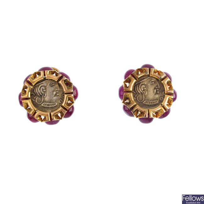 A pair of ruby cluster earrings.