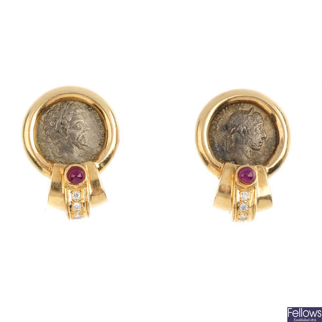 A pair of ruby and diamond earrings.