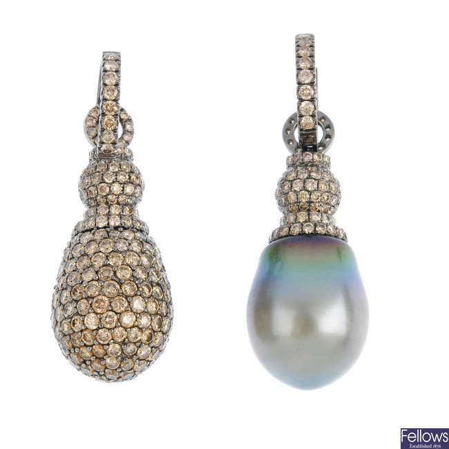 A pair of diamond and cultured pearl earrings.