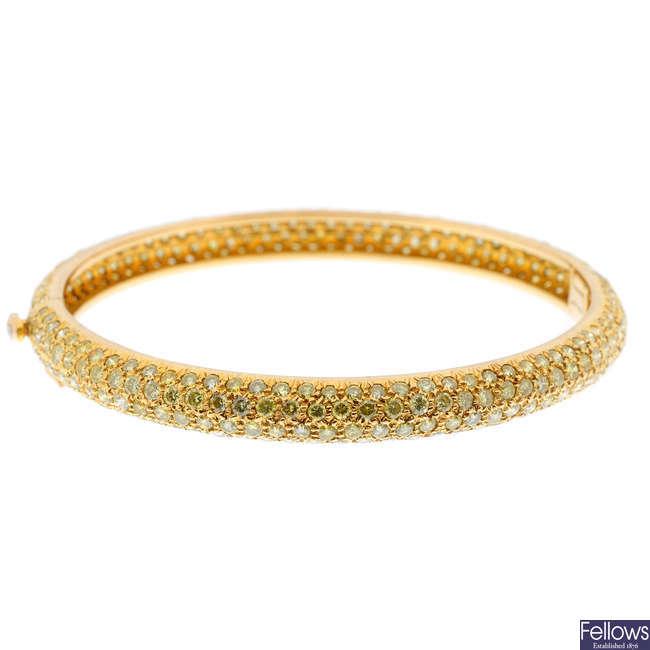 A 'yellow' diamond bangle.