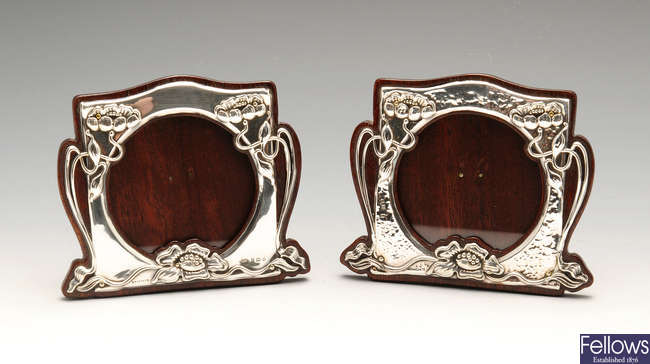 A pair of similarly matched Art Nouveau silver mounted photograph frames.
