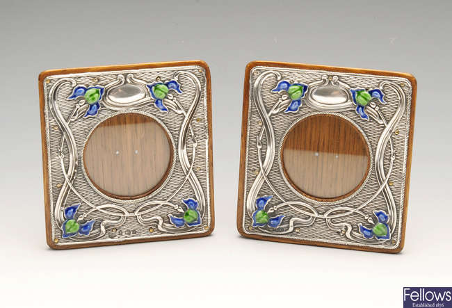 A matched pair of Art Nouveau silver mounted photograph frames.