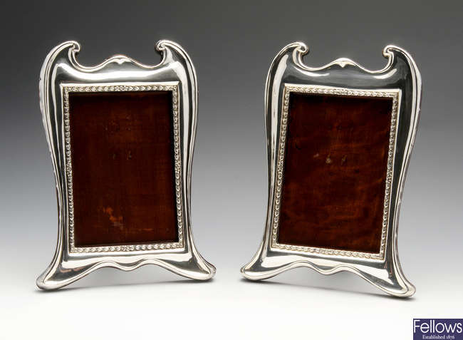 A matched pair of early twentieth century silver mounted photograph frames.