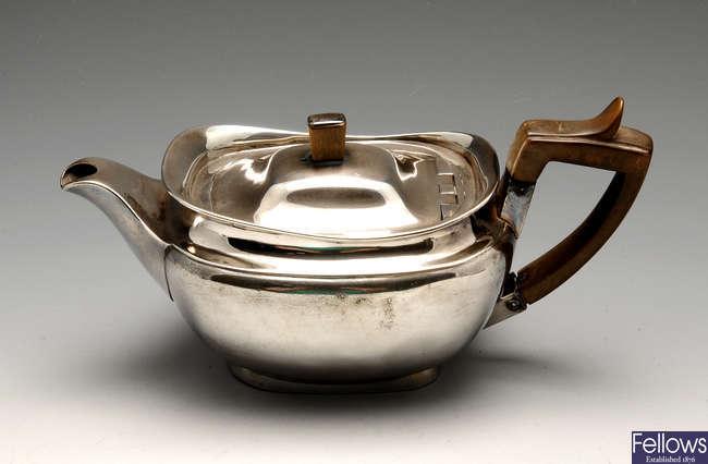 A George III silver bachelor teapot.