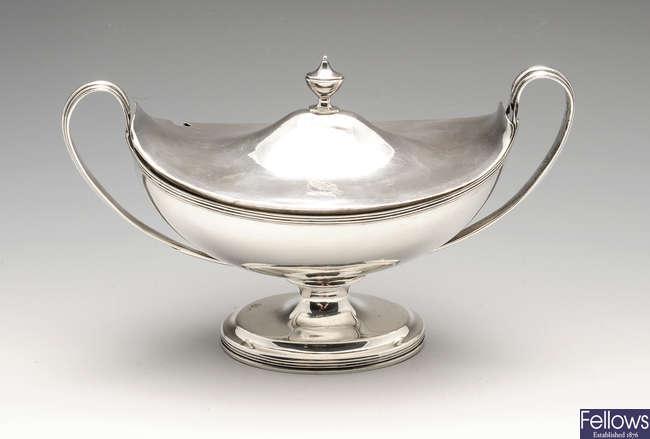 A George III silver twin-handled sauce tureen & cover.