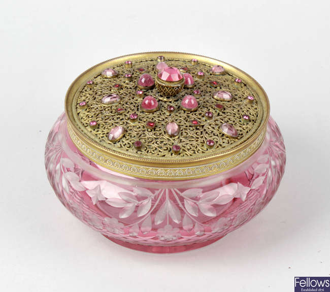 A pink cut glass lady's vanity jar and cover.
