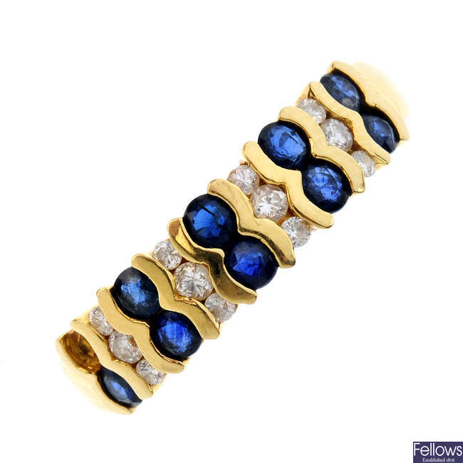 An 18ct gold sapphire and diamond ring. AF.