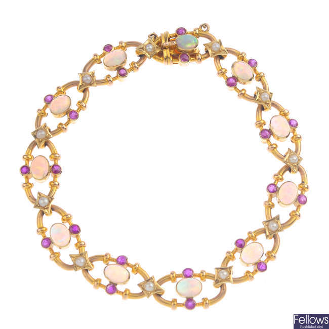 An early 20th century 15ct gold opal, ruby and split pearl bracelet.
