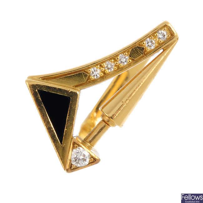 An onyx and diamond dress ring.