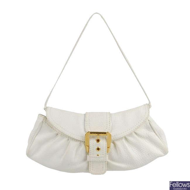 CÉLINE - a white leather Pochette handbag.