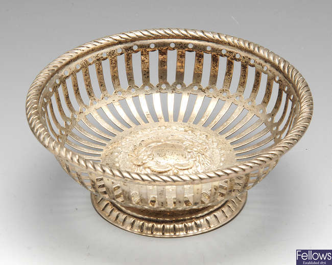 A late Victorian silver bonbon dish, etc.