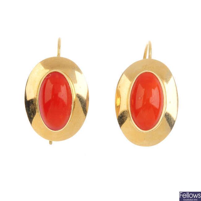 A pair of coral earrings.